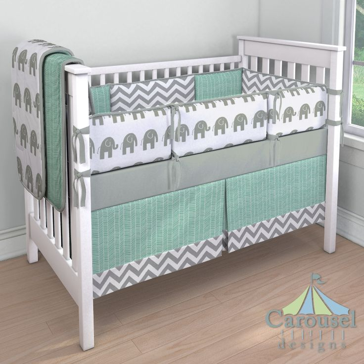 Crib bedding in White and Gray Zig Zag, Mint Herringbone, White and Gray Elephants, Solid Cloud Gray. Created using the Nursery Designer® by Carousel Designs where you mix and match from hundreds of fabrics to create your own unique baby bedding.