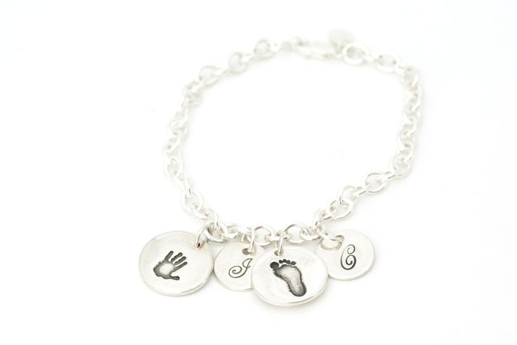 Two Handprint Charms and Initial Charms on a Charm Bracelet