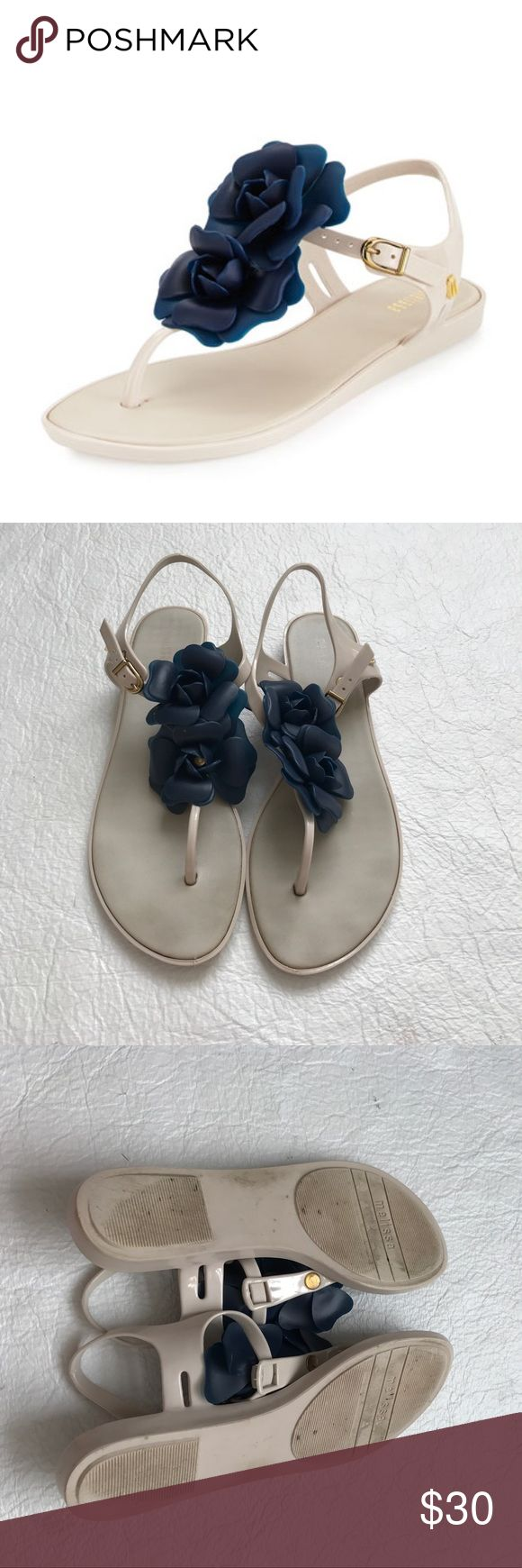 Melissa Solar Sandals Taupe with navy flower. VGUC. Small signs of wear but nothing major. Smells amazing and will leave your feel smelling like my little pony! 37 Brazil or 8 USA. Melissa Shoes Sandals