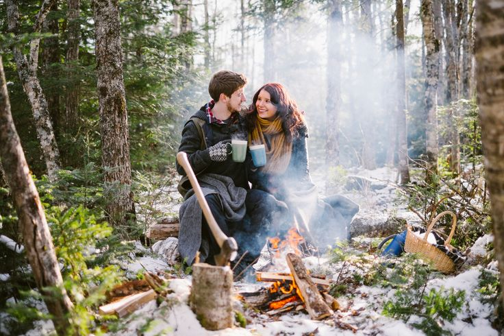 A winter engagement session by  a camp fire - hot chocolate in hand and wool blankets at the ready. Captured just outside of Truro, Nova Scotia.