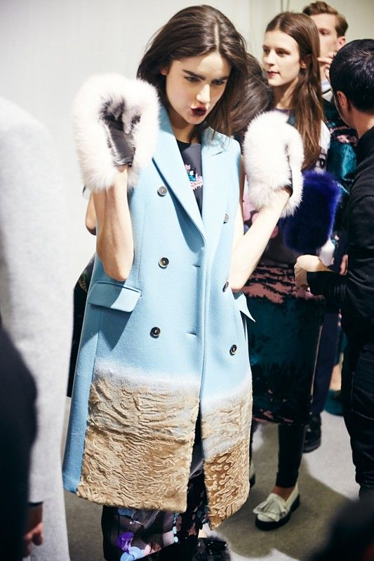 Furry boxing gloves and blue ombre coats backstage at MSGM AW14 MFW. More images here: http://www.dazeddigital.com/fashion/article/18988/1/msgm-aw14