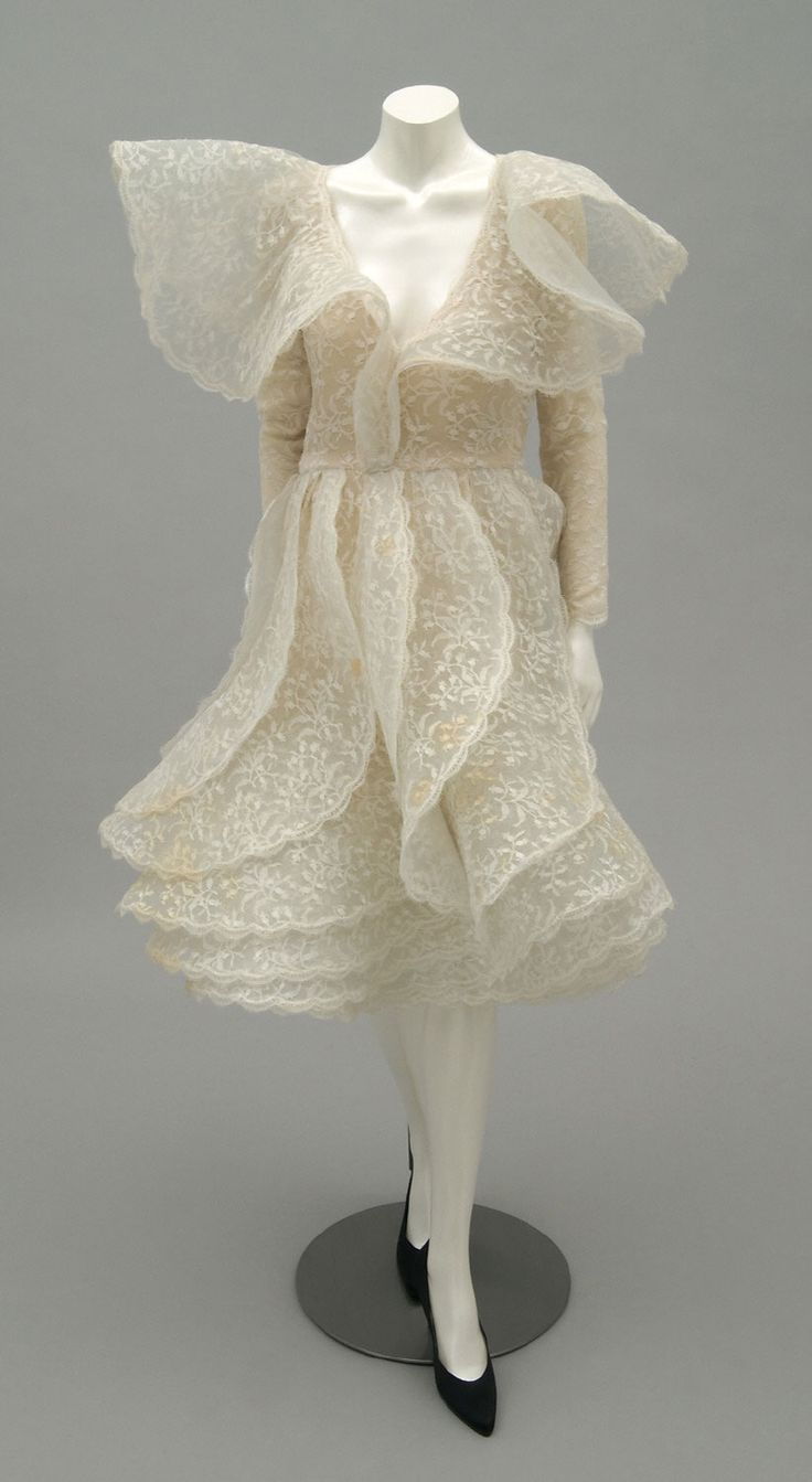 Designed by Pierre Cardin, French (born Italy), born 1922 Geography: Made in France, Europe Date: c. 1987 Medium: Synthetic lace over nylon...