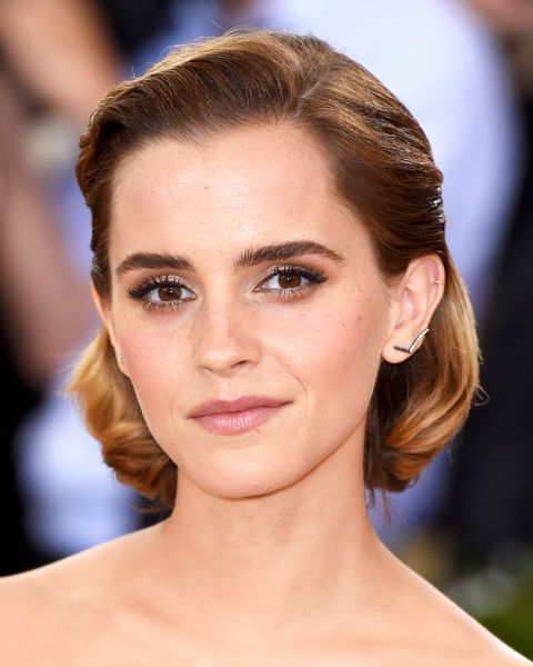 Side parted, slicked back and curled under, Emma Watson's bob isa sculptural feat.