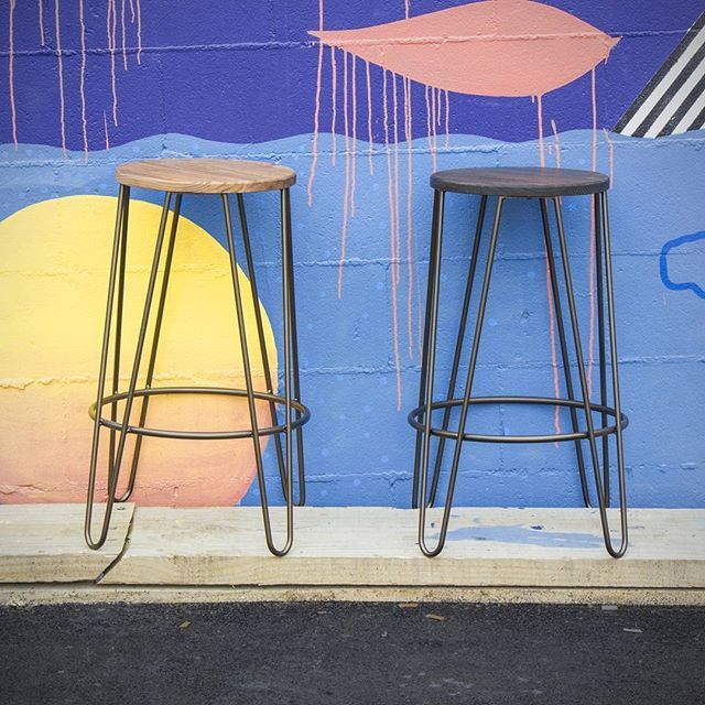 Bar Stools in copper with light elm and dark elm seats.
