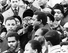 """Stokely Carmichael (June 29, 1941 – November 15, 1998) was a black activist active in the 1960s American Civil Rights Movement...He rose to prominence in the civil rights and Black Power movements, first as a leader of the Student Nonviolent Coordinating Committee, and later as the """"Honorary Prime Minister"""" of the Black Panther Party..."""