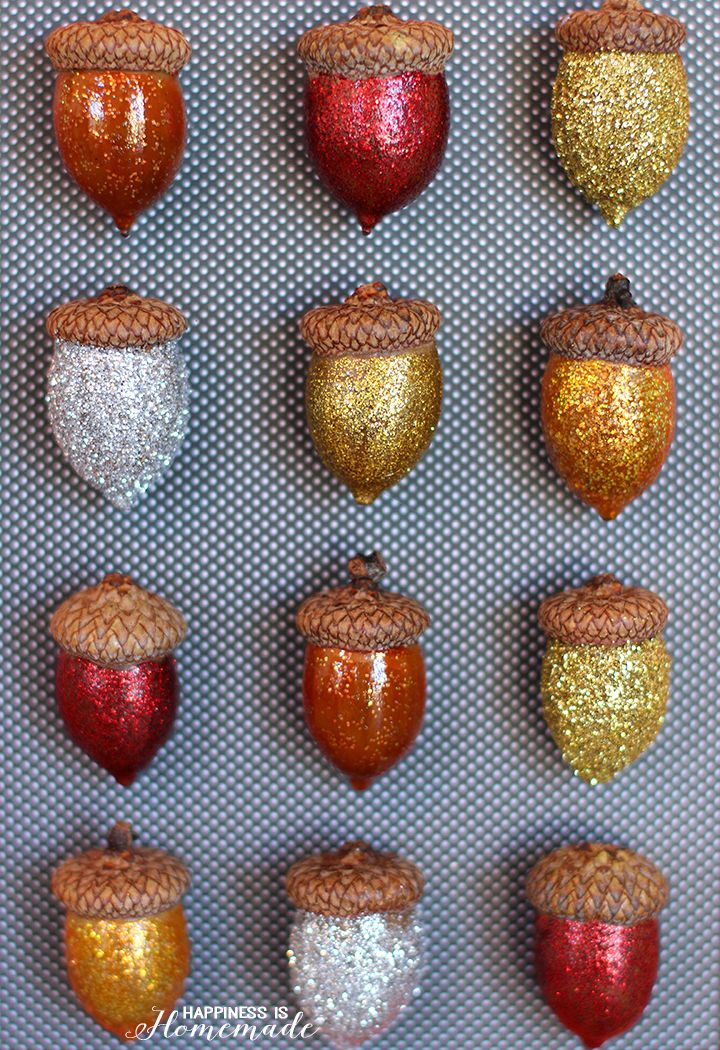 Glitter acorns are easy to make and are perfect for festive, DIY Thanksgiving decor. Make a couple dozen of them and put them in mason jars or vases or easy DIY table decor for fall.