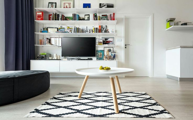 Interior design with Scandinavian elements andacollection ofpopart.  Realization of interior_ living room_ scandinavian elements_ pop art _ table tablo_ Normann Copenhagen_ large table white