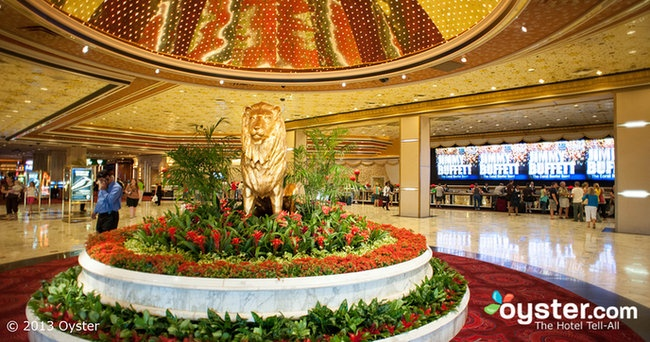 Lobby at the MGM Grand Hotel in Las Vegas. They are giving off abit of a ''green'' look in the middle of the lobby but really its a lobby envisioned as a dynamic multi use space. Theres loads or room in the lobby with different exits all around it so alot of different things could be going on there.