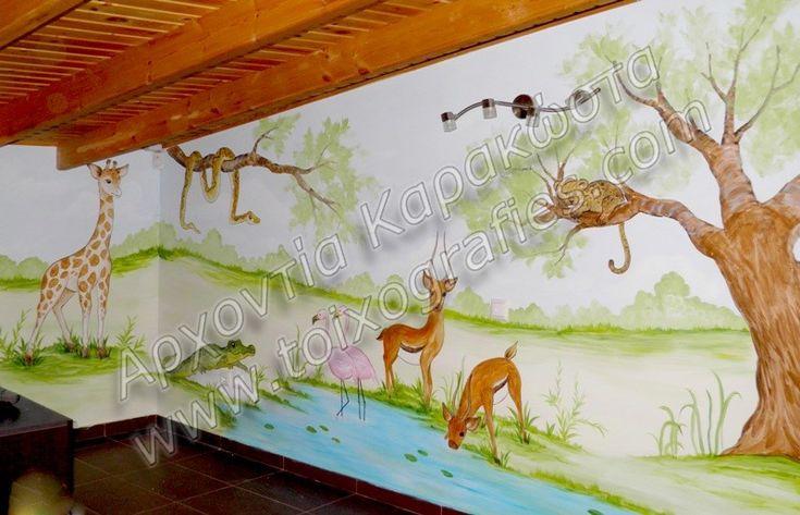 Παιδικό δωμάτιο με ζωγραφική στους τοίχους. Παιδική τοιχογραφία με χαρούμενα χρώματα και θέμα τα αγαπημένα ζώα του παιδιού. Ζώα της ζούγκλας, σαφάρι και περιπέτειες στην Αφρική.…