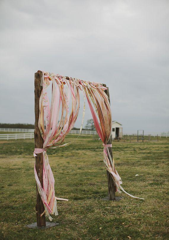 ribbon ceremony arch | photo by Tessa Harvey | http://www.100layercake.com/blog/2013/07/10/outdoor-texasfarm-wedding-ashley-adam/