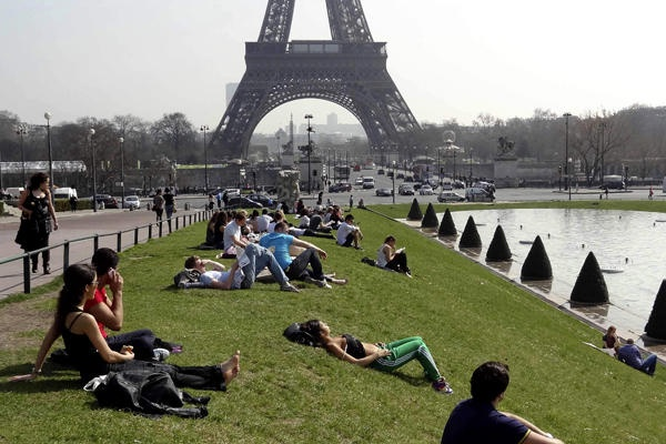 People relax in the sun near the fountains at Trocadero square near the Eiffel Tower as unusually warm temperatures hit Paris.    Charles Platiau/ReutersHit Paris, Parisj Taime, Parise J T Aim