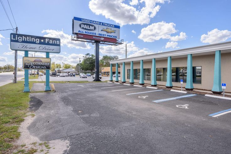 Incredible SR 200 frontage. One of the most travelled and occupied corridors in Ocala. Beautiful retail space with multiple offices, a conference room, 2 AC units (approx. 6 yo), Roof (2013), 25 parking spaces (resurfaced w/in last 3 yrs), 4 Bay Doors with loading dock, there is room for a semi! So many opportunities w/ lighting grid & security system installed. Also includes Firewall and VPN