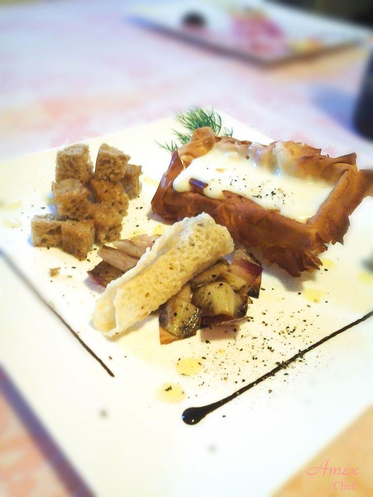 Fonduta di pecorino su vaschetta di pasta phillo, pane casareccio e radicchio rosso spadellati, cono di parmigiano riempito di radicchio.