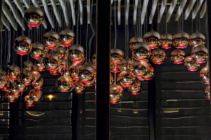Hanging red feature lighting, Cicchetti, reflecting beautifully in mirror