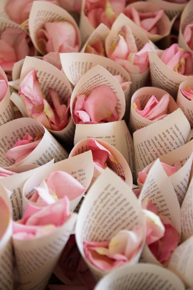 Wrap rose petals inside your favorite quote on love or a copy of a favorite book page.  Guests can through the petals in front of the bride and groom when they leave.