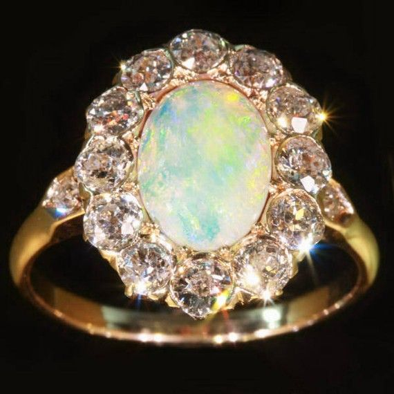 Antique Victorian engagement ring with large opal  and diamonds. Opals were very popular, given mainly as wedding gifts or engagement rings. Queen Victoria gave parures or tiaras containing opals to many of her daughters and daughters-in-law on their weddings.