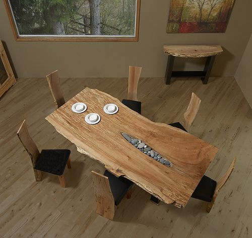 We've been crazy for live-edge slab tables for a while. This one, with the river stone inclusions is particularly nice.