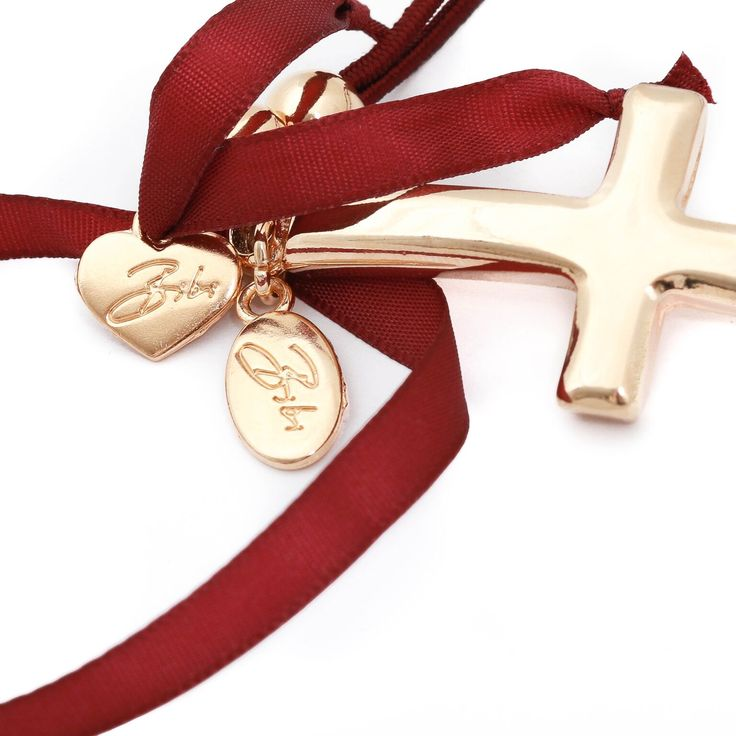 Bibi Bijoux Burgundy Ribbon and Gold Cross stretch bracelet. £50