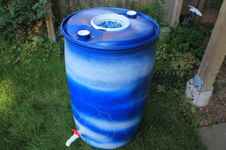 """-FOR SALE- Rain barrel #003 """"Lightning In A Barrel"""" Photo #1 of 3 Complete with 5' of overflow tubing, colored cleanable aquarium gravel filter system & all hardware parts are replaceable. One of a kind, hand painted with Krylon Fusion paint for plastic."""