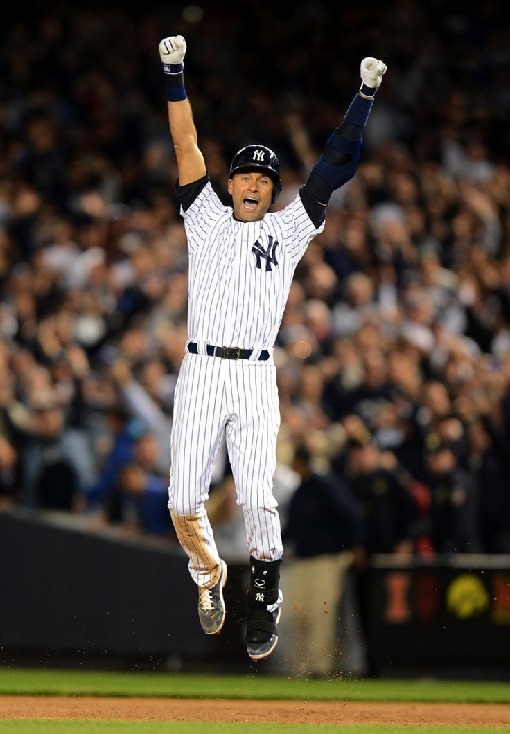 New York Yankees shortstop Derek Jeter celebrates as he ends the game with a walk off during his last game at Yankee Stadium. The now retired shortstop led the New York Yankees to a dramatic victory against the Baltimore Orioles with a final score of 6-5.