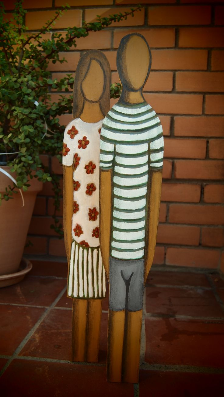 wood figurines hand made. stripes and flowers