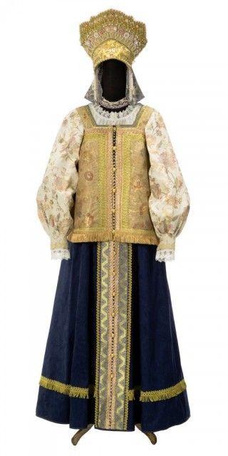 Russian traditional woman's costume, with kokoshnik headpiece.