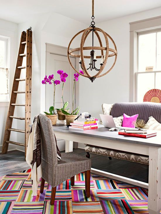 Love the hits of color and the unique desk couch combo for the home office as well as the light fixture