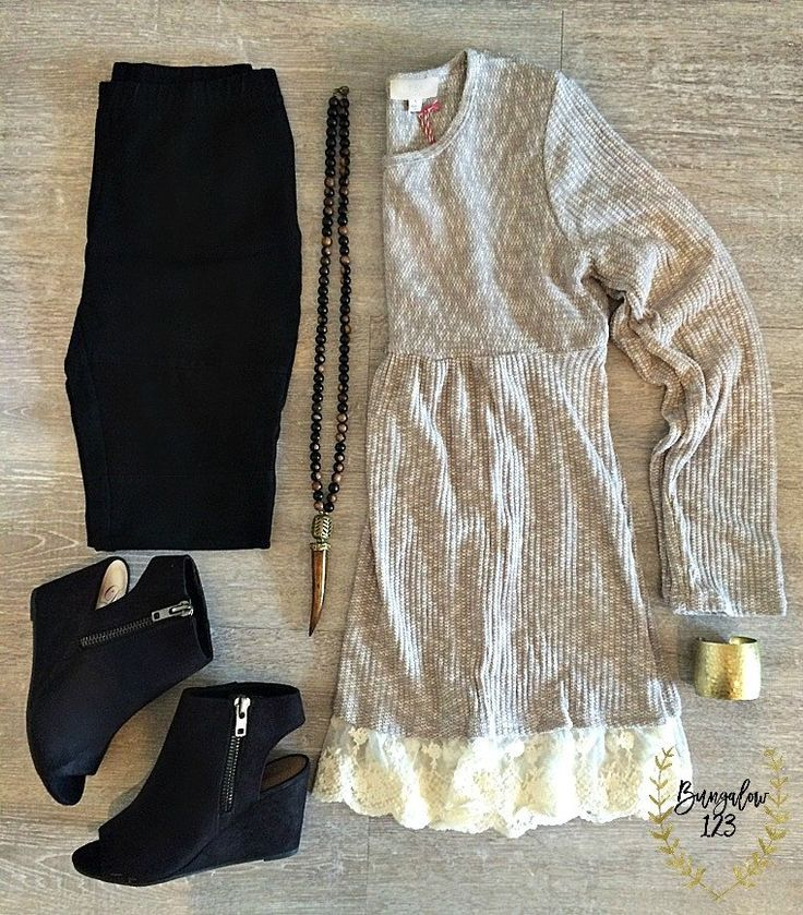Melange knit sweater in Grey and White featuring lace detail along hem. Empire waist. One of our B123 Seamless Camisoles work great under this. Poly/Cotton blend. Shown with the B123 Jeggings in Black