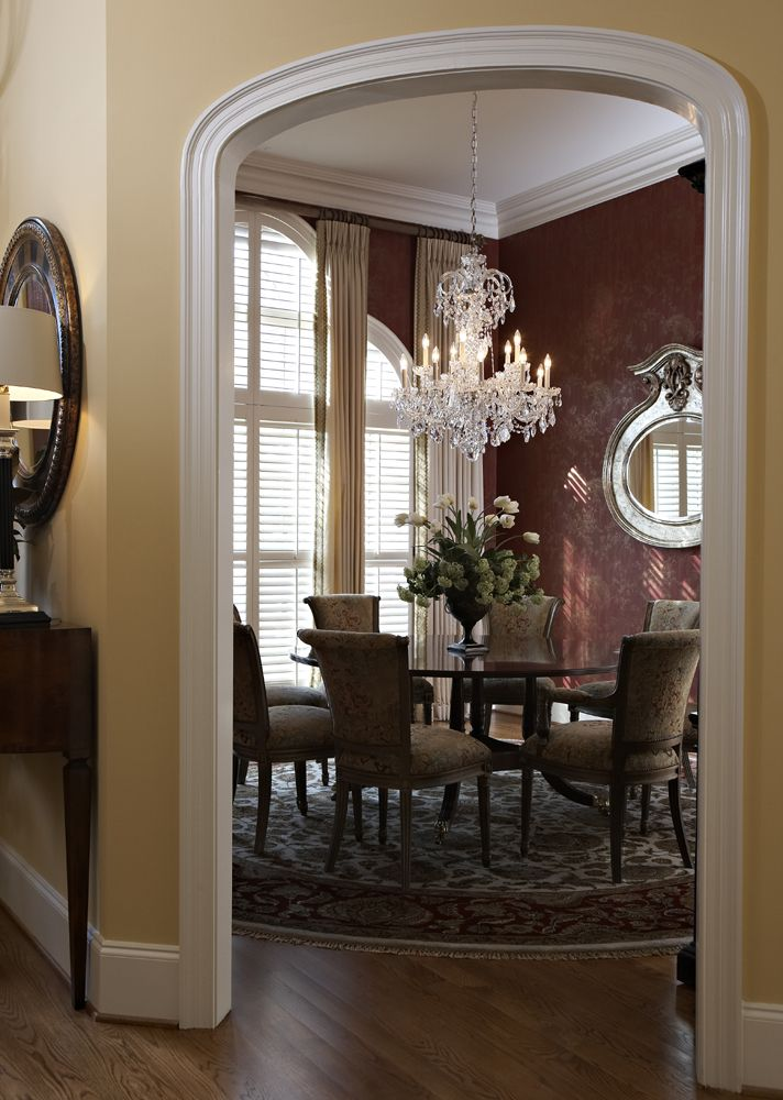 Burgundy and cream formal dining room - awesome chandelier!