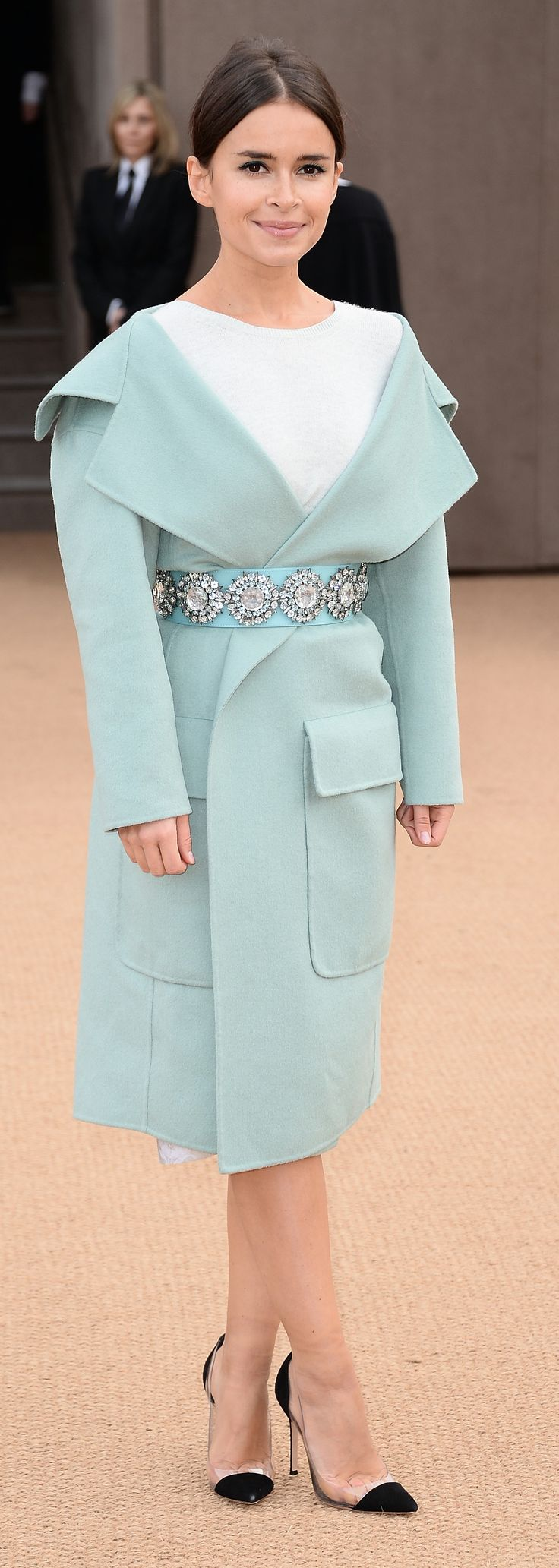 Mira Duma wearing Burberry Prorsum outerwear and a gem embellished belt at the Burberry A/W14 Show in London