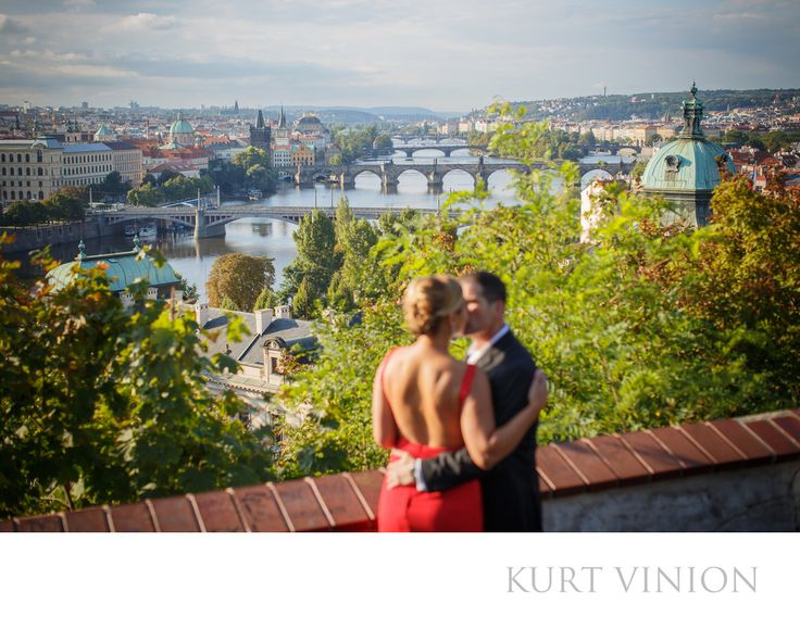 London wedding & Prague pre wedding photographer - A romantic engagement kiss overlooking Prague: L&G romantic engagement portrait session in Prague. Keywords: Prague Engagement Photography (24).