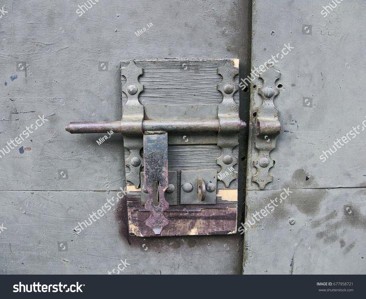 closed metal door with lock. Closeup of old lock on metal garage door