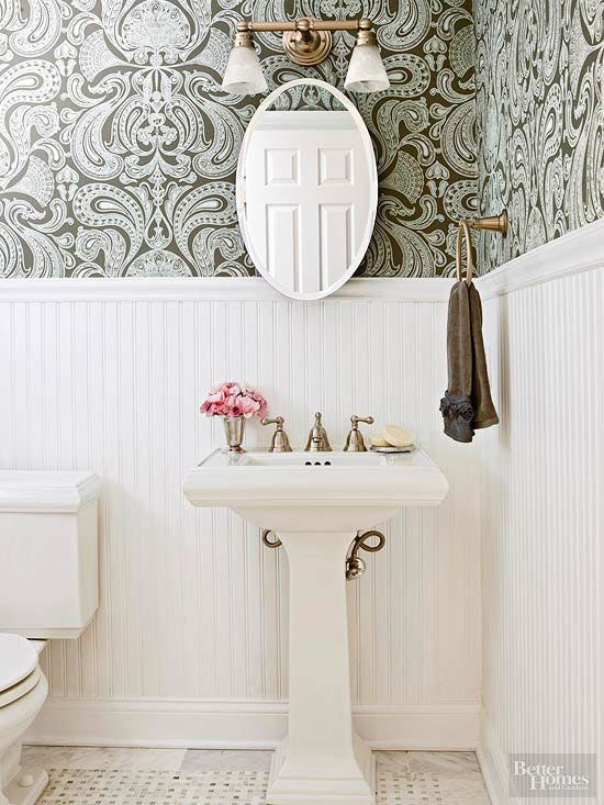 With just a few affordable changes, this powder room got an elegant new look. A slender pedestal sink adds a graceful shape to the room without taking up much space. The easy-to-clean wainscoting behind the sink adds a pretty architectural element in this small bath. Installing the painted beaded board just past the midpoint of the wall draws the eye up and lends a sense of height and a layer of charm. Total Cost: $2,355
