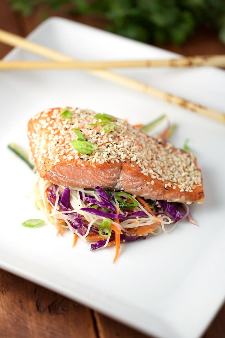 Honey lime glazed salmon with sesame rice noodle salad is a healthy and refreshing meal. Crunchy and cool vegetables tossed with a savory sesame dressing.