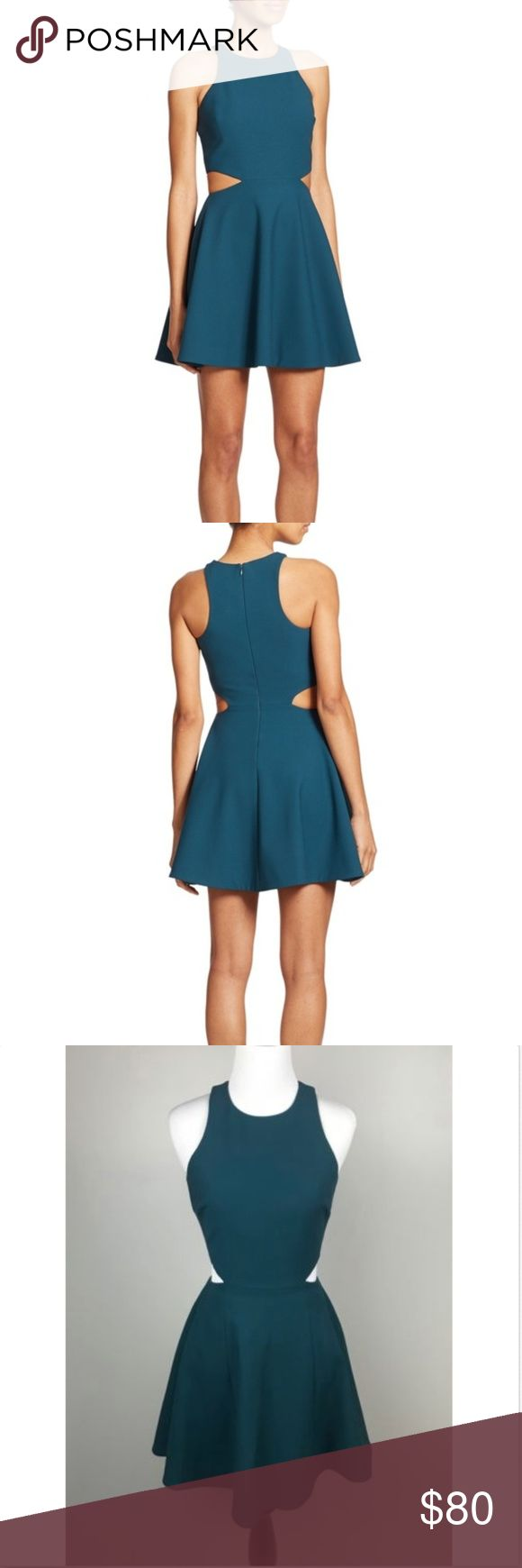 "Elizabeth and James Teal Emory Cut Out Dress Elizabeth and James Size 2 Dress Emory Cut Out Dress Teal Fit & Flare Sleeveless  Measurements Laying Flat:  Armpit to Armpit: 14.5"" Length: 33"" Elizabeth and James Dresses"