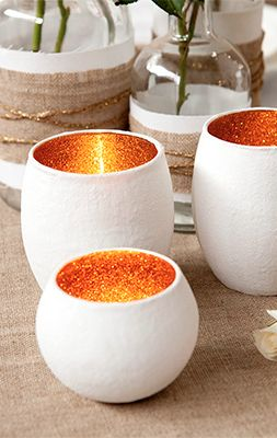 Glitter Glass Votives. coat clear glass votive with glitter/mod poge mix as many applications as you like, cover that with paint that matches glitter, finally cover that with white paint