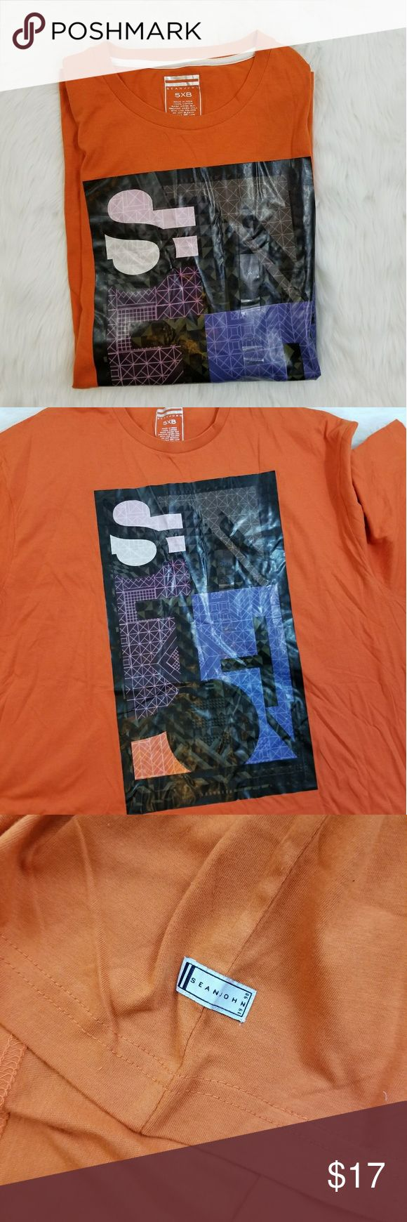 Sean Jean Orange Graphic Short Sleeve Tee 5XB Brand new with tags. No rips or stains. The graphic on the t shirt looks off centered to me and there is a very tiny pin sized hole on the collar. Shown in photo #4. Men's size 5XB. Sean John Shirts Tees - Short Sleeve