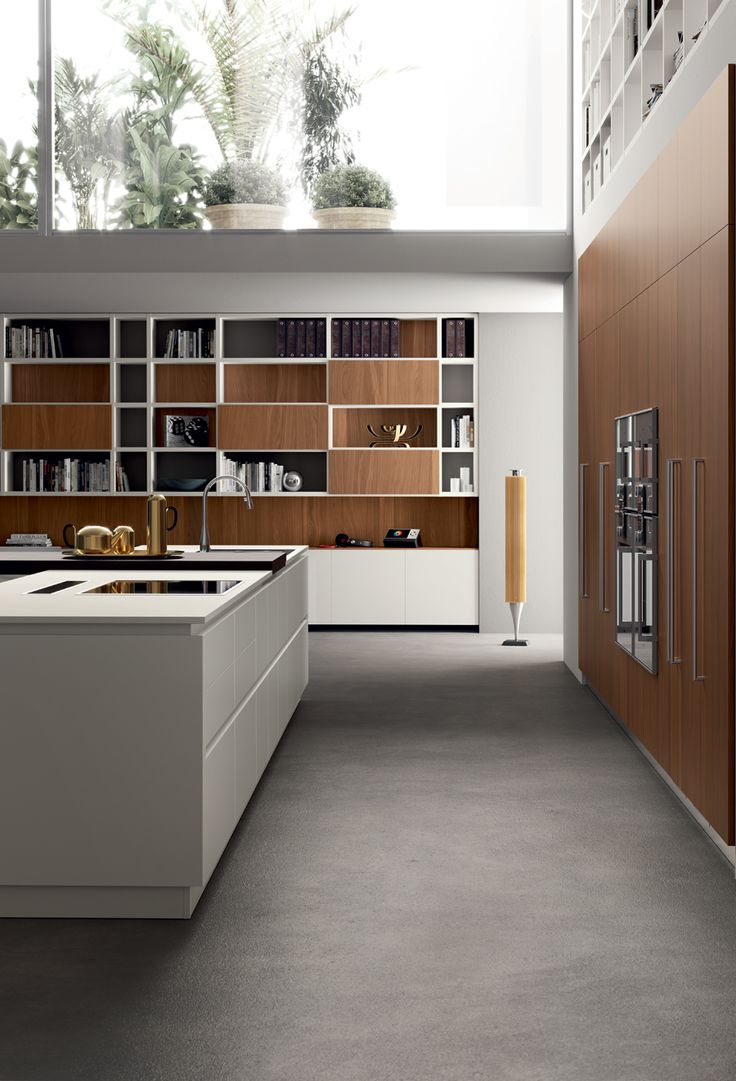 """Clean lines are also the distinguishing feature of the """"Fluida"""" wall system, with 22 mm thick Tussah Walnut fi nished doors; the same fi nish is also applied to the wall claddings, for a truly eye-catching ensemble."""