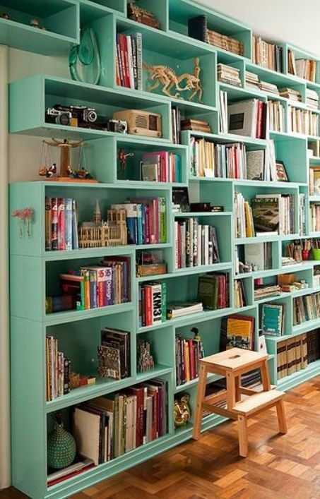 Make bookcase out of old boxes attached to wall. Use wood offcuts to create further shelving options. Paint all one colour to co-ordinate.