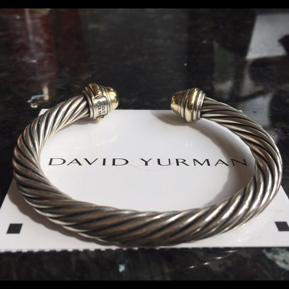 David Yurman 7mm cable bracelet silver & 14kt gold Authentic David Yurman 7mm cable bracelet. Sterling Silver and 14-karat yellow gold in excellent condition. This pre-owed bracelet comes with a certificate of authenticity and proof of Nordstrom department store receipt. This piece is so gorgeous a true classic wardrobe staple. David Yurman Jewelry Bracelets