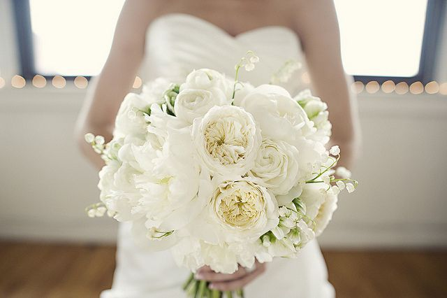 gorgeous combination of peonies, garden roses and lilies of the valley.