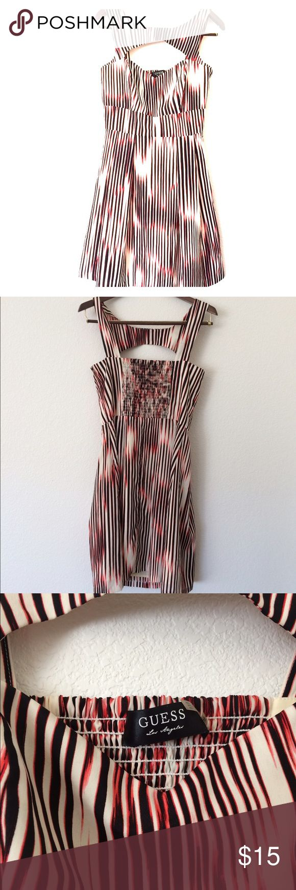 Bright and Flattering Guess Dress. Never worn Guess dress size 10. Colorful with a unique chest cut. The skirt is float and fun. Don't miss this designer dress at a great price!! Guess Dresses