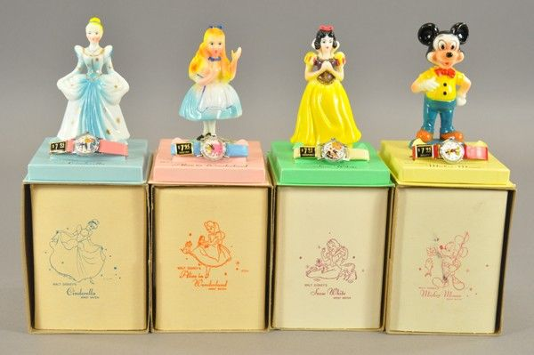 Timex watches with matching Disney figurines from the 60's.