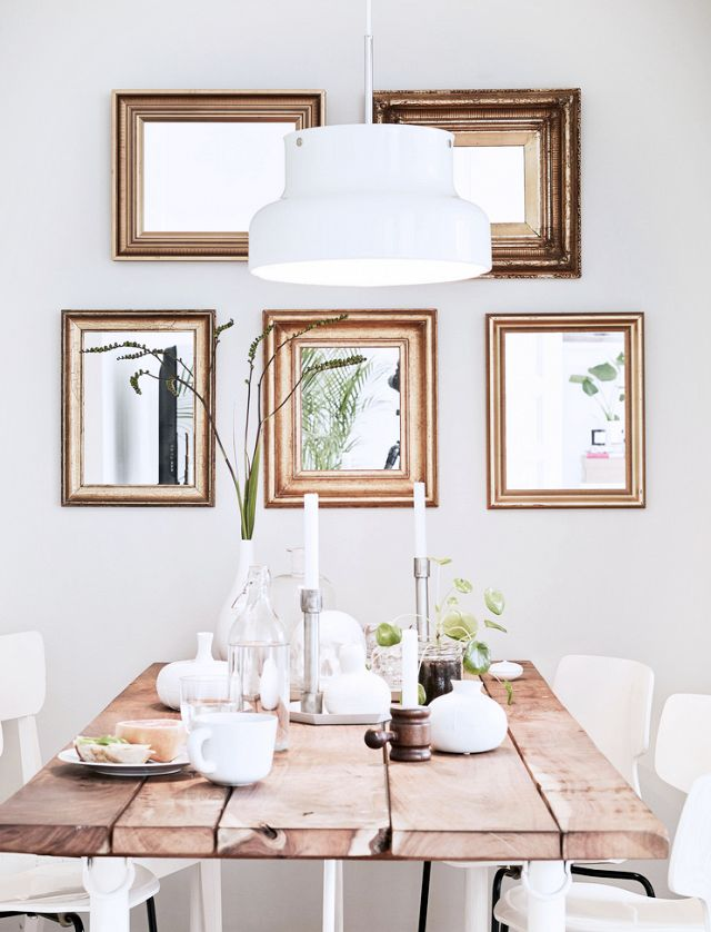 This rustic, feminine dining space is simple and earthy, but still feels special thanks to its collection of gilded mirrors.