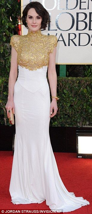 Going for gold: Michelle Dockery looks stunning in a Alexandre Vauthier dress as she arrives at the Golden Globe Awards