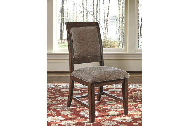 Dinner guests are sure to linger longer, given the inviting comfort of the Windville upholstered side chair. Richly textured, the plush chenille-feel upholstery wraps the front and back, bringing a soft and sumptuous element to Windville's richly rustic presence.