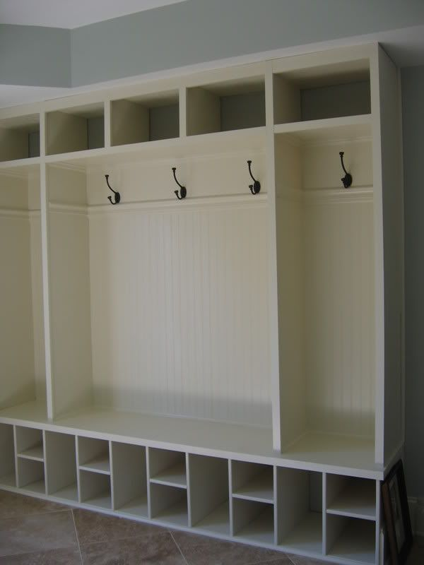 I want to knock out a wall in my front hall that leads into a closet and build built in cubbies