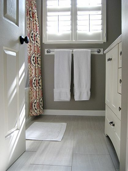 love the grey walls with white accents and a patterned shower curtain