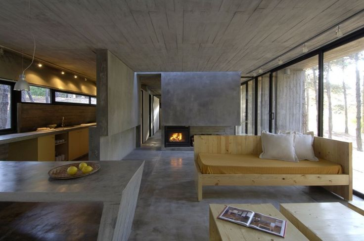 Concrete House / BAK Architects - All the concrete makes it a little drab, but not depressing. The light wood (unfinished pine?) furniture contrasts nicely though.