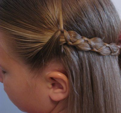 This braid looks complicated, but is just a regular braid, but with 2 thin and 1 thick section.  (BTW the side has a zillion other cute little girl hairstyles)